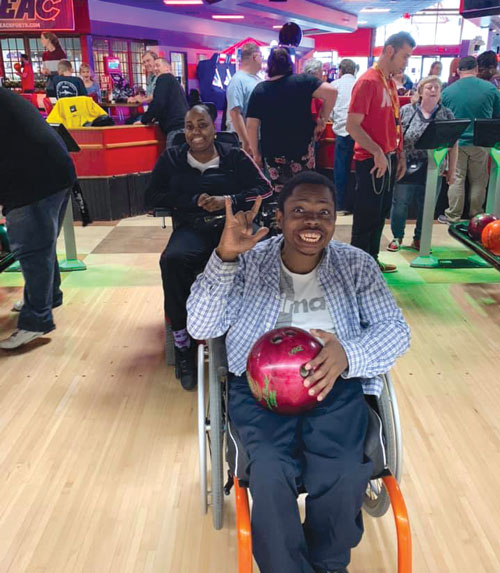 Man with wheelchair bowling